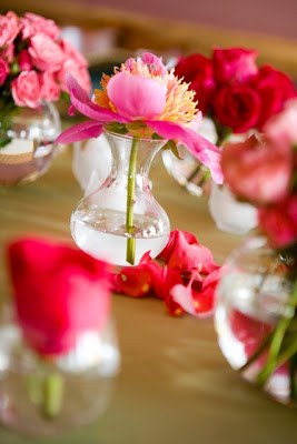 Different flowers in the same hue can grace a table in separate vases.