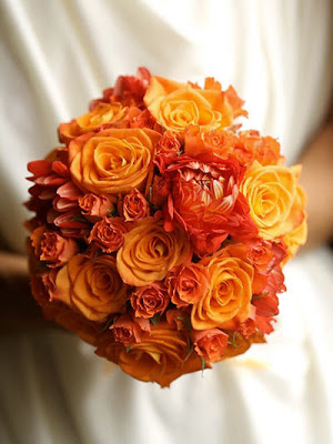 Orange roses, spray roses and Dahlias are gorgeous in this monochromatic bouquet.