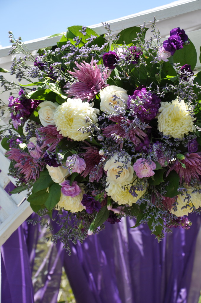 purple-wedding-arch-floral-spray-floweduet