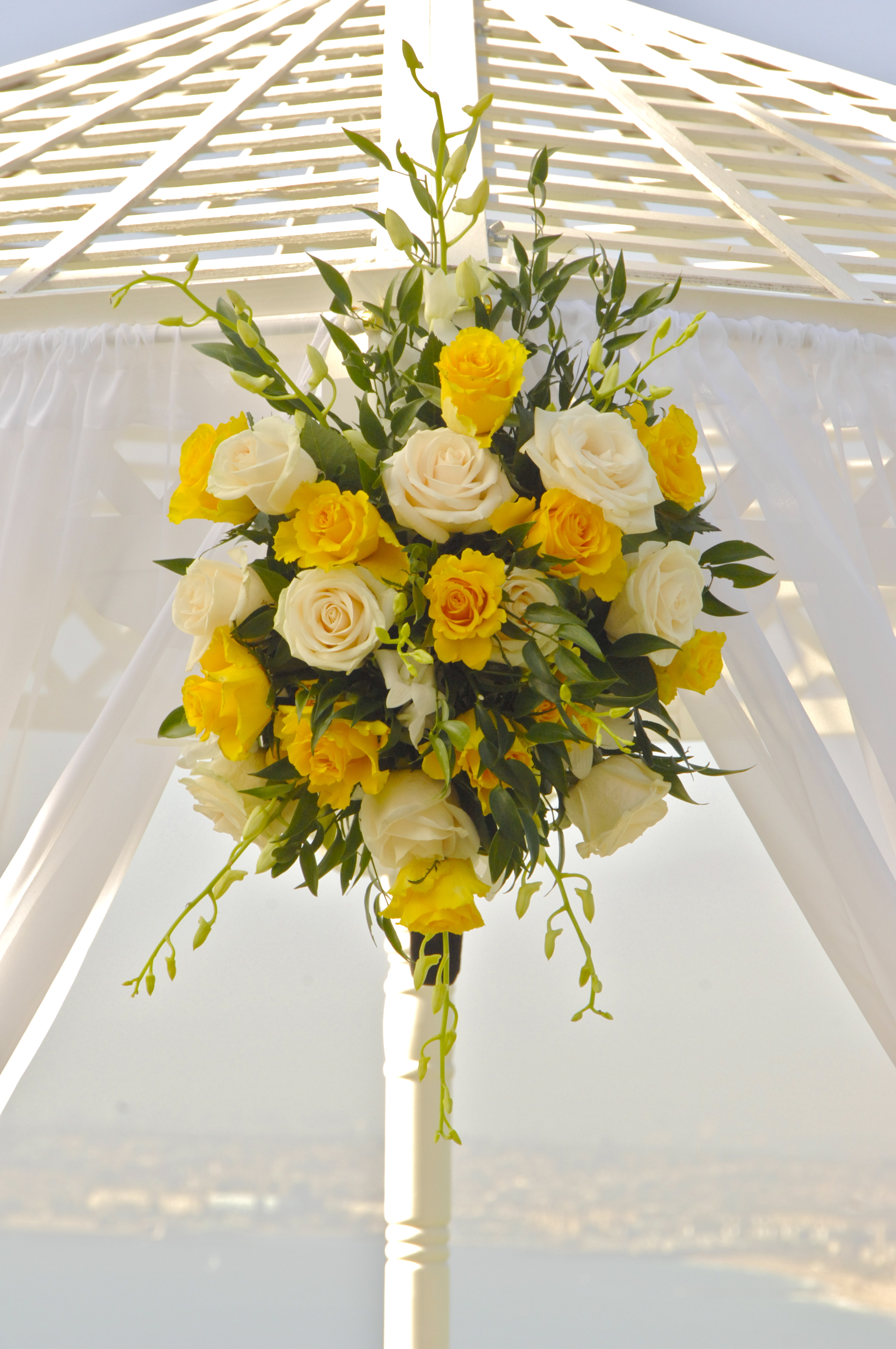 Yellow wedding arch flowers mightylinksfo