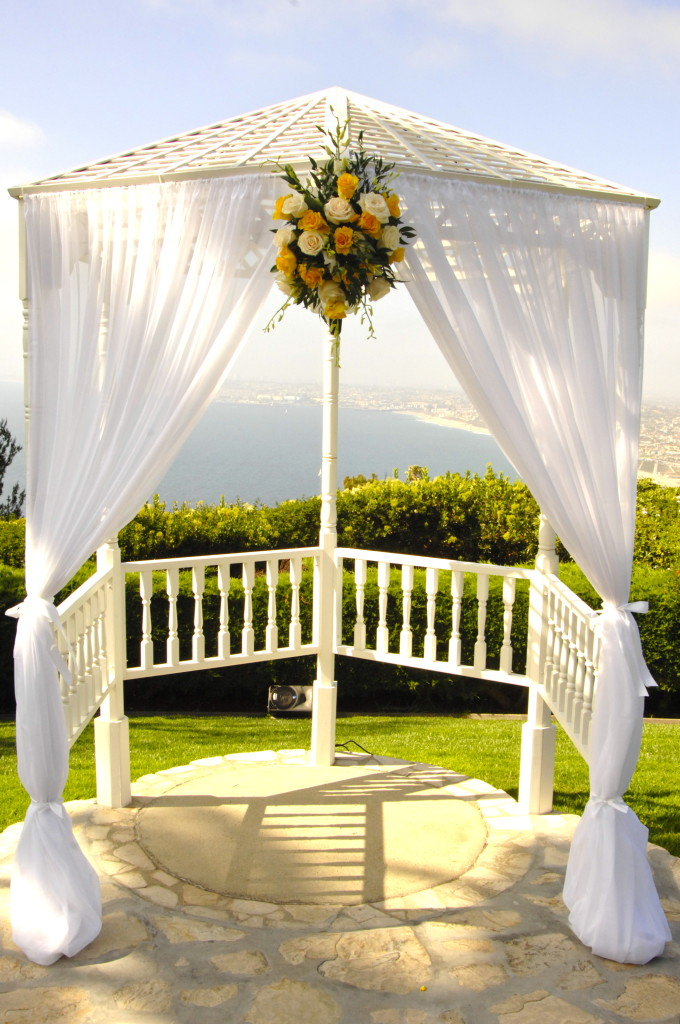 yellow and white wedding arch flowers