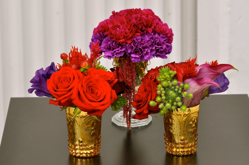 Gold cocktail vases with purple and red flowers