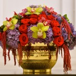 Centerpiece for French Circus theme - golds, green, burgundy flowers