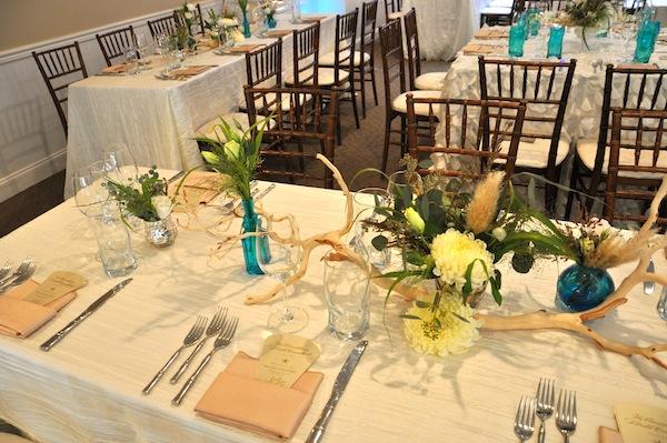flowerduet.com-blue-seaglass-bottles-bleached-manzanita-beach-wedding-flowers