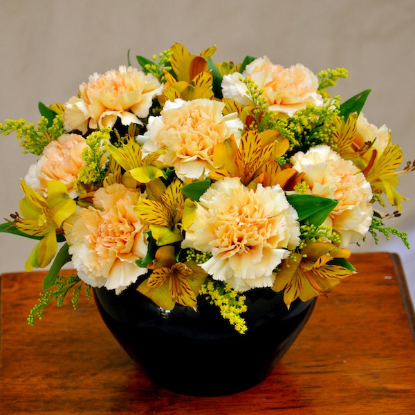 Yellow carnations like these are considered novelty. In this simple deisgn, we added solidago and yellow alstromeria to round out the design. Flowers by Flower Duet. Photo by Kit Wertz.
