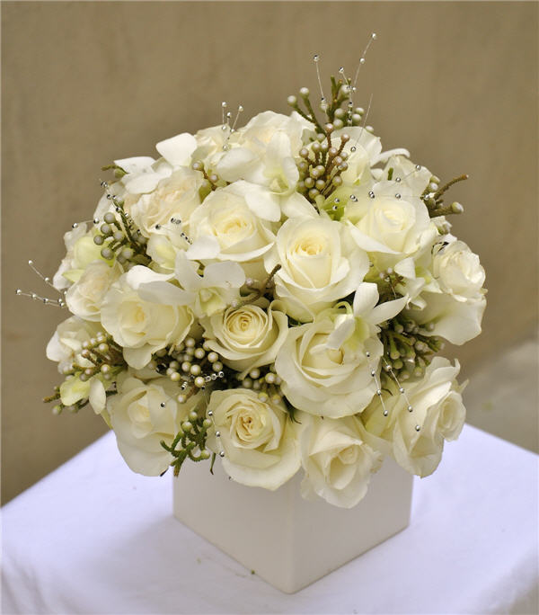 White flowers for winter celebrations and home winter white bridal bouquet with silver accents mightylinksfo