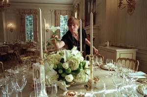 White House Chief Florist Nancy Clarke completes an arrangement of white lilies, white roses, hydrangea, and limes before a dinner in the State Dining Room. Source: Wikipedia.com