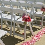 Aisle Decor for an outdoor wedding with petals and vases.