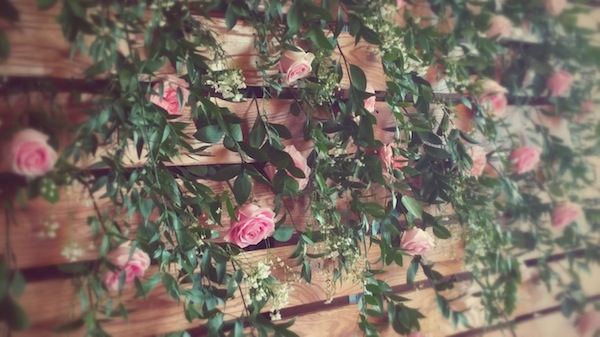 Joanna requested a flower wall for the shoot so we came up with a lightly peppered wall of greenery and pink roses, highlighted by fresh Gyp.