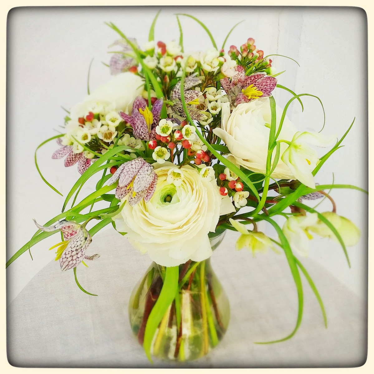 March 2016 newsletter flowerduet spring fritillaria stems and ranunculus make an impact in a small bud vase flowers by flower duet photo by kit wertz reviewsmspy