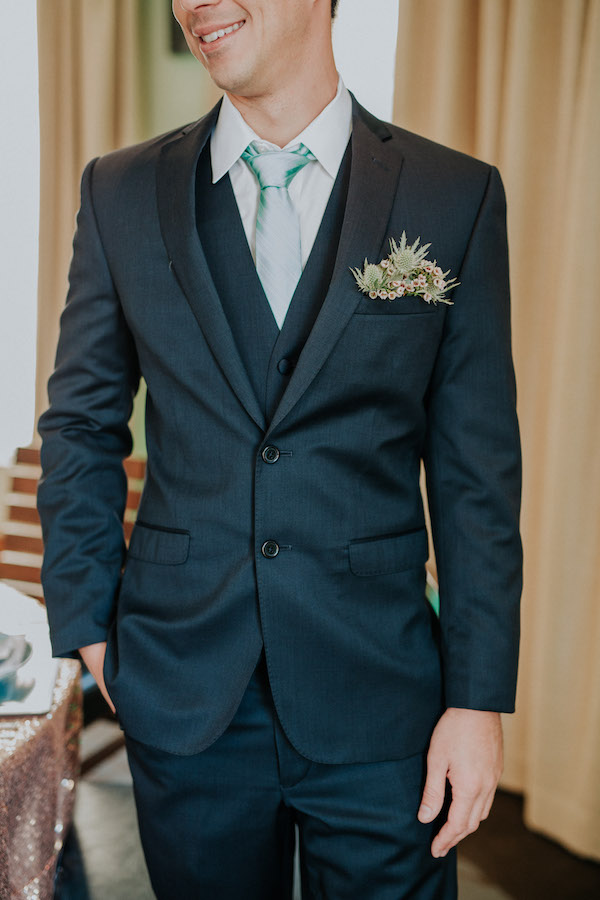Floral pocket square replaces a traditional boutonniere on this groom to be! Styling by The Events Boutique. Flowers by Flower Duet. Photo by Dave Richards Photography.