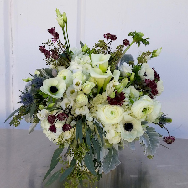 White Anemone floral design by Flower Duet. Photo by Kit Wertz
