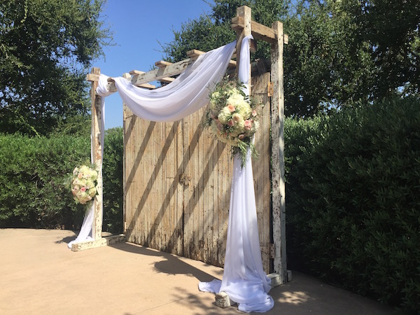 Ceremony draping by Flower Duet with floral sprays