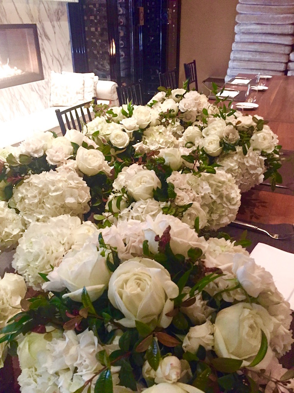 Photo by Casey Schwartz. White Hydrangea and white rose centerpieces.