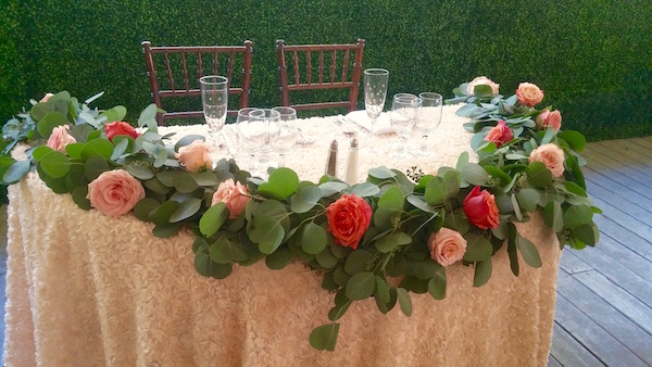Garland for sweetheart table.