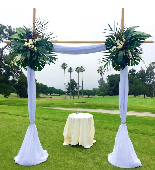 Tropical floral sprays for an ocean side wedding.