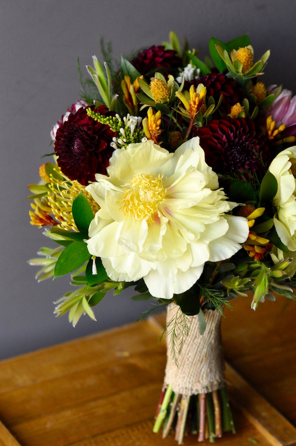 Yellow peony bridal bouquet by Flower Duet.
