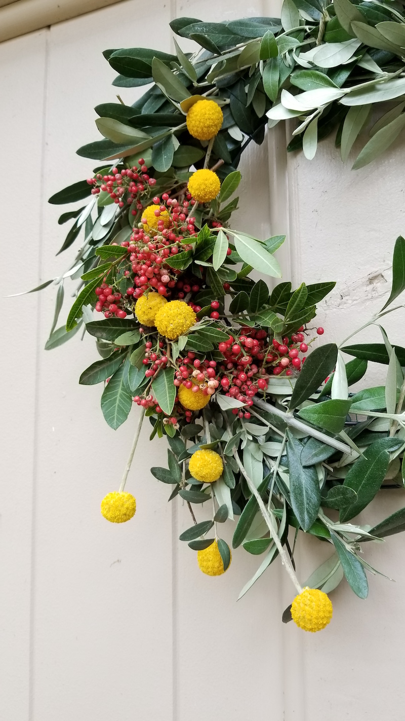 Olive Wreath with Yellow flower accents by Flower Duet