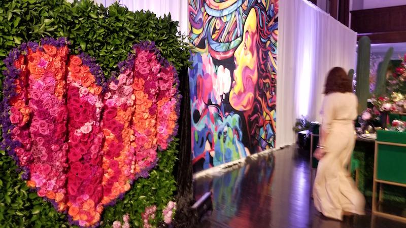 Flower Duet's flower graffiti wall complements the real-life graffiti art