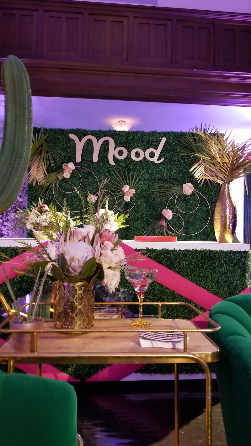 Here is a couch perspective of the Palm Springs section of our display. We created a flower wall treatment with gold hoops, plams and flowers.