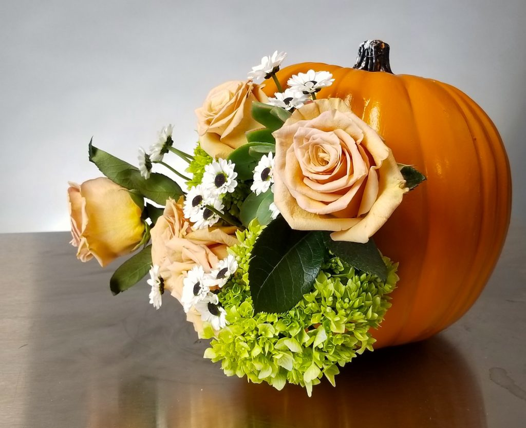 Side view of Diorama floral pumpkin. Flowers by Flower Duet. Photo by Kit Wertz.