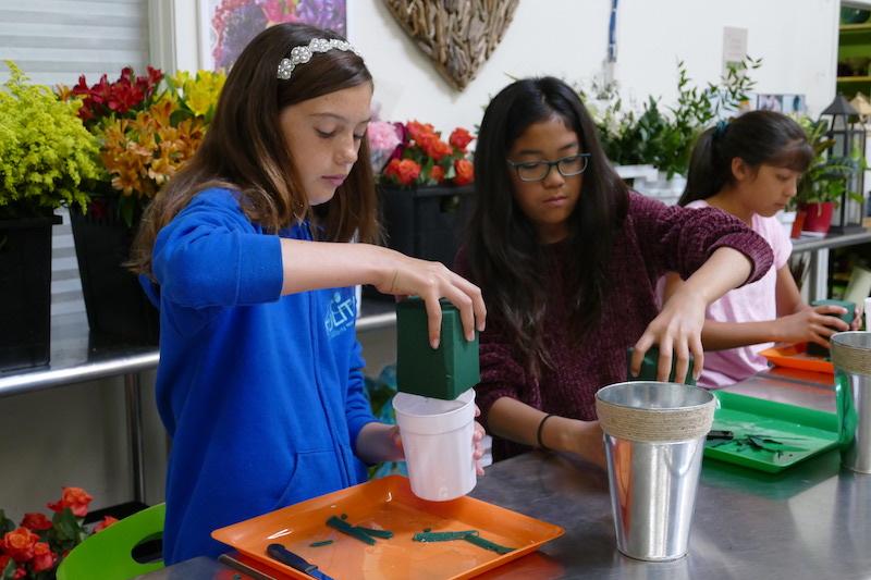 Girls make flowers in Flower Duet's 2019 LIving Art Flower Camp