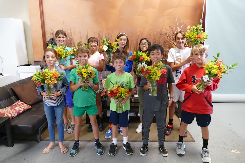 Some of the campers pose with their vases of fresh floral designs during our 2019 Living Art Camp.
