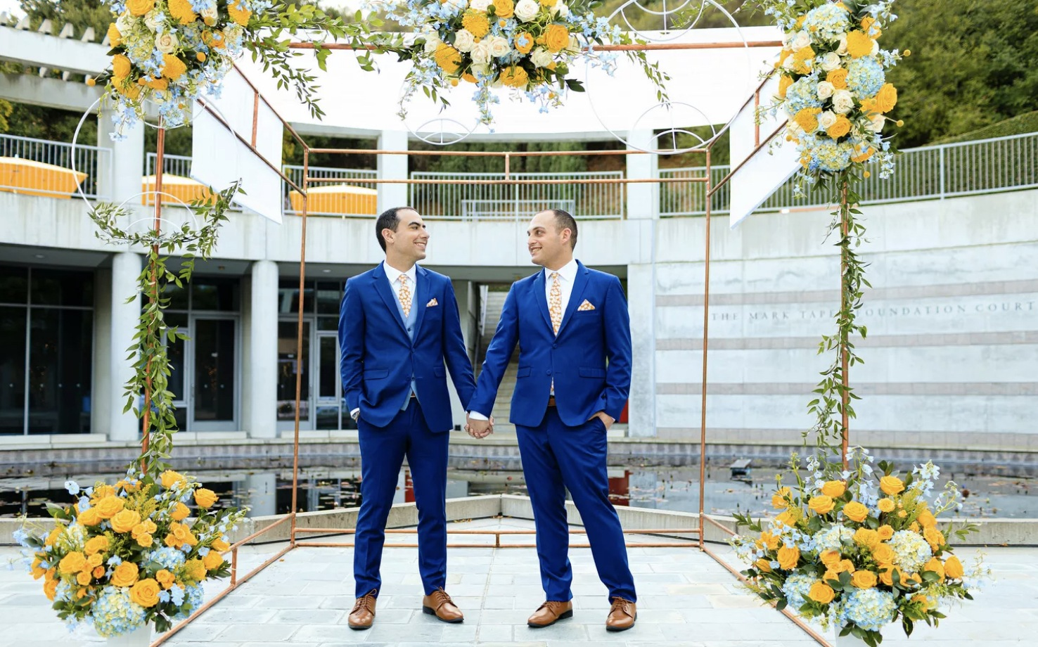 Grooms Married under Yellow and Blue Chuppah