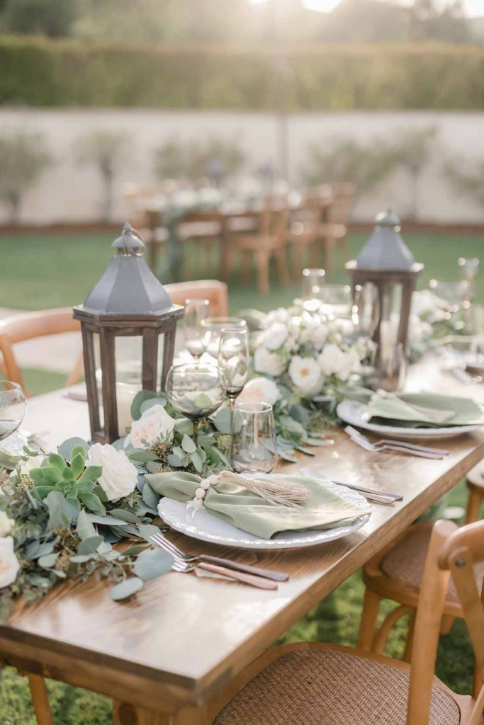 Table Setting with garlands for outdoor wedding
