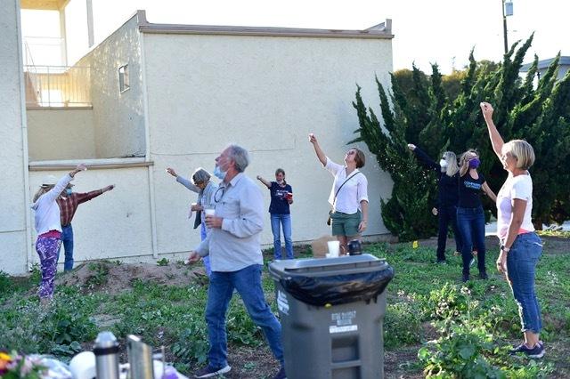 The neighbors toasting