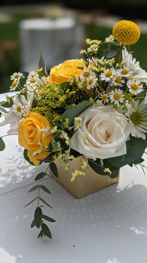 Yellow wedding cocktail flowers
